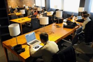"""ITAR-TASS: MOSCOW, RUSSIA. MARCH 20, 2013. People at VAO Coworking Centre, Russia's first government-owned facility of the kind. The centre is located at the premises of the state-funded enterprise Maly Biznes Moskvy [Small Businesses of Moscow] in the Eastern Administrative District of Moscow (VAO). (Photo ITAR-TASS/ Sergei Fadeichev) Ðîññèÿ. Ìîñêâà. 20 ìàðòà. Ïîñåòèòåëè âî âðåìÿ ðàáîòû íà òåððèòîðèè êîâîðêèíã-öåíòðà ÂÀÎ, ñîçäàííîãî íà áàçå ãîñóäàðñòâåííîãî áþäæåòíîãî ó÷ðåæäåíèÿ """"Ìàëûé áèçíåñ Ìîñêâû"""". Ôîòî ÈÒÀÐ-ÒÀÑÑ/ Ñåðãåé Ôàäåè÷åâ"""