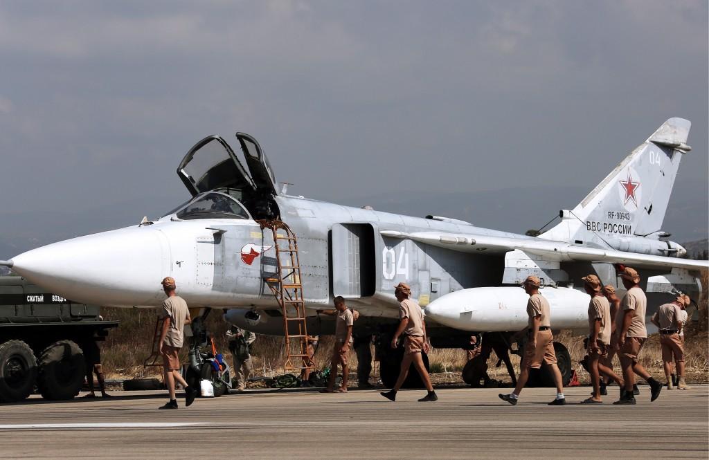 """LATAKIA, SYRIA. OCTOBER 4, 2015. Russia's Sukhoi Su-24 attack aircraft at the Hmeymim airbase. TASS Ñèðèÿ. Ëàòàêèÿ. 4 îêòÿáðÿ 2015. Ðîññèéñêèé ôðîíòîâîé áîìáàðäèðîâùèê Ñó-24Ì íà àâèàáàçå """"Õìåéìèì"""". ÒÀÑÑ"""