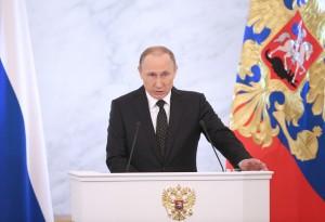 MOSCOW, RUSSIA. DECEMBER 3, 2015. Russia's President Vladimir Putin delivers his annual address to the Federal Assembly, at the Moscow Kremlin. Sergei Bobylev/TASS Ðîññèÿ. Ìîñêâà. 3 äåêàáðÿ 2015. Ïðåçèäåíò Ðîññèè Âëàäèìèð Ïóòèí âî âðåìÿ âûñòóïëåíèÿ ñ åæåãîäíûì ïîñëàíèåì ê Ôåäåðàëüíîìó Ñîáðàíèþ ÐÔ â Êðåìëå. Ñåðãåé Áîáûëåâ/ÒÀÑÑ