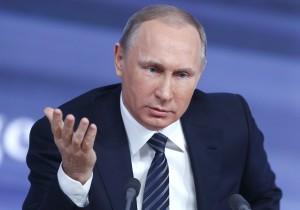 MOSCOW, RUSSIA. DECEMBER 17, 2015. Russia's President Vladimir Putin speaks during his annual press conference at Moscow's World Trade Center. Mikhail Japaridze/TASS Ðîññèÿ. Ìîñêâà. 17 äåêàáðÿ. Ïðåçèäåíò Ðîññèè Âëàäèìèð Ïóòèí âî âðåìÿ ïðåññ-êîíôåðåíöèè â Öåíòðå ìåæäóíàðîäíîé òîðãîâëè. Ìèõàèë Äæàïàðèäçå/ÒÀÑÑ
