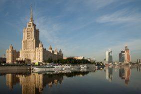"""ITAR-TASS: MOSCOW, RUSSIA. MAY 23, 2012. A 206 metre Stalinist skyscraper housing the Radisson Royal Hotel (L), by the Moskva River. Upon its completion in 1957, the building became the largest hotel in Europe, known as the Ukraina (Ukraine) Hotel. In 2010 the hotel was renamed following an extensive renovation. (Photo ITAR-TASS / Alexandra Krasnova)  Ðîññèÿ. Ìîñêâà. Ãîñòèíèöà Ðýäèññîí Ðîéàë (áûâøàÿ ãîñòèíèöà """"Óêðàèíà""""). Ôîòî ÈÒÀÐ-ÒÀÑÑ/ Àëåêñàíäðà Êðàñíîâà"""