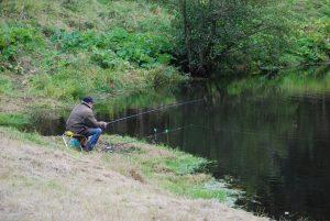 Рыбак у пруда в Шишкином лесу.